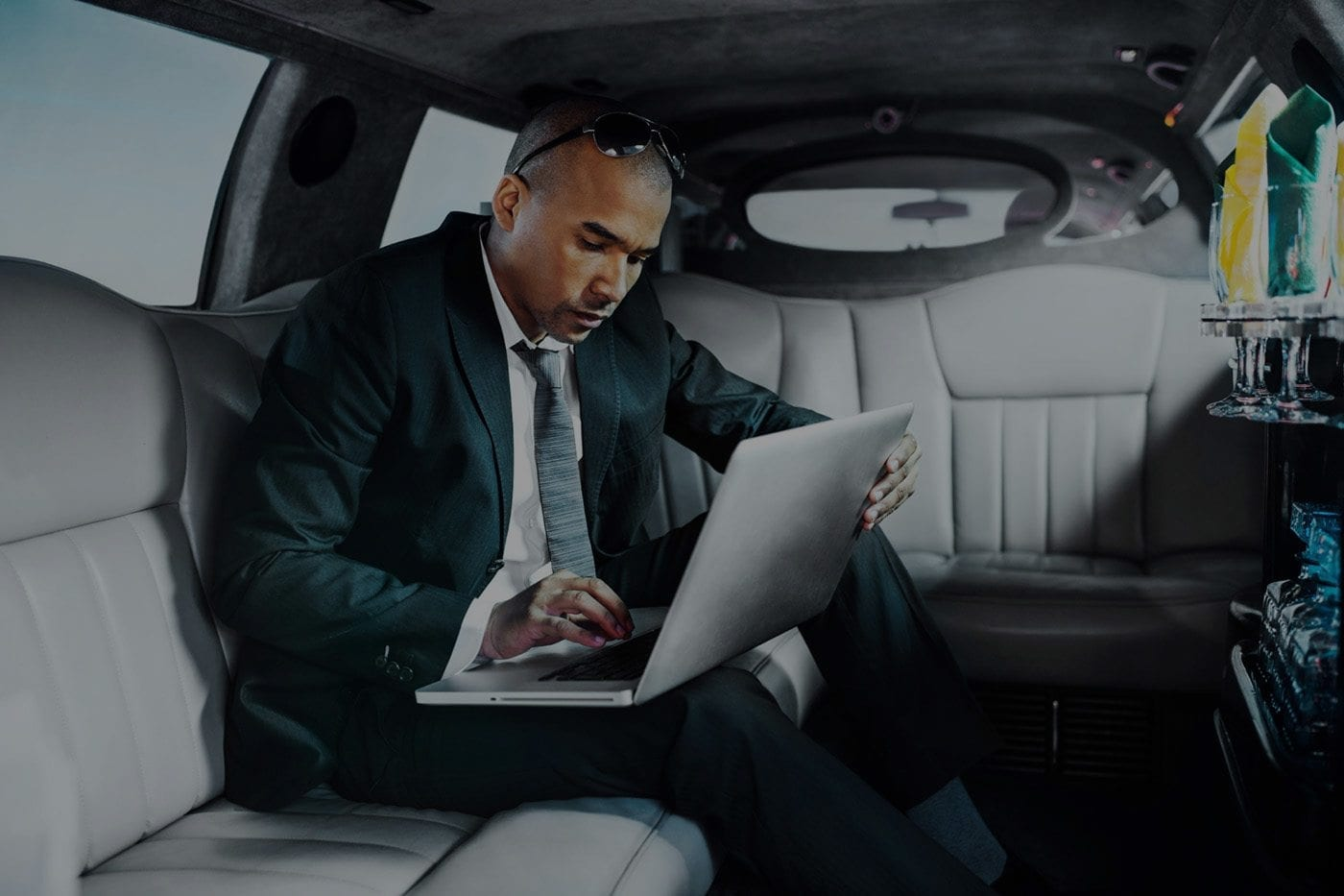 Man in limo working on a laptop
